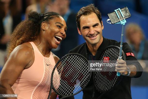 Serena Williams of the United States and Roger Federer of Switzerland take a selfie following their mixed doubles match during day four of the 2019...
