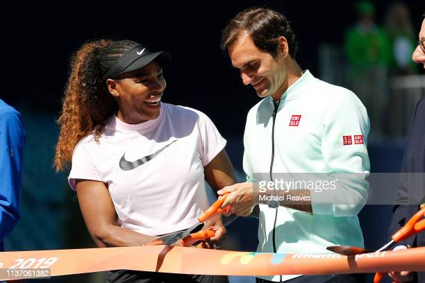 Serena Williams of the United States and Roger Federer of Switzerland cut the ribbon during the Ribbon Cutting ceremony on Day 3 of the Miami Open...