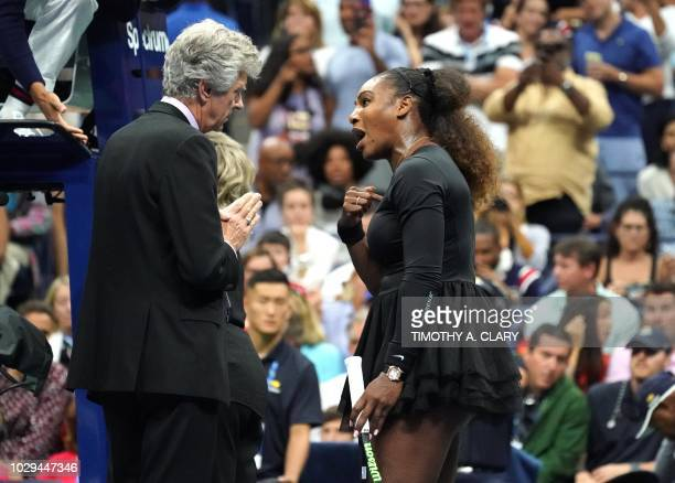 TOPSHOT Serena Williams of the United States argues with referee Brian Earley during her Women's Singles finals match against Naomi Osaka of Japan at...