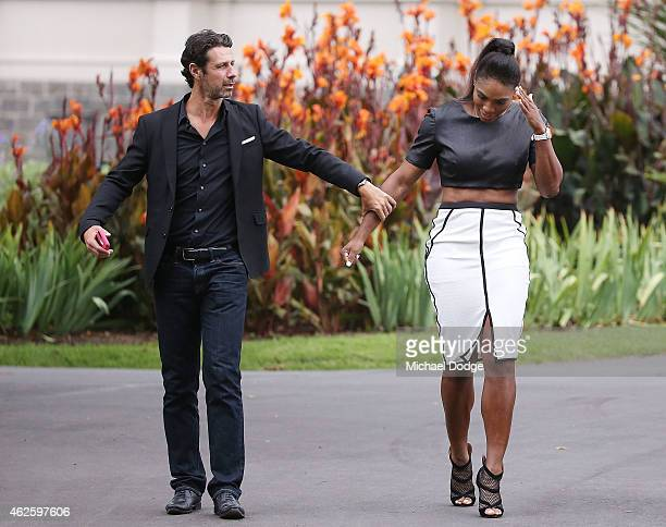 Serena Williams of the United States arrives with her partner and coach Patrick Mouratoglou during a photocall at The Royal Exhibition Building in...