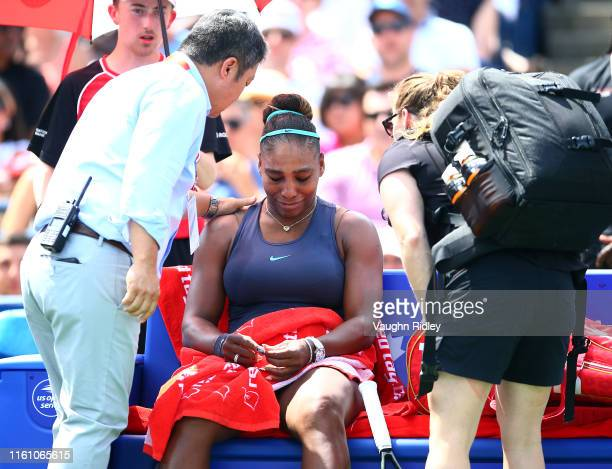Serena Williams of the United States becomes upset after withdrawing from the final match against Bianca Andreescu of Canada due to a back injury on...
