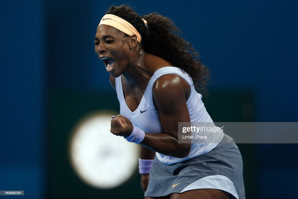 Serena Williams of the United States celebrates a ball during her women's quarterfinals match against Caroline Wozniacki of Denmark on day seven of the 2013 China Open at the National Tennis Center on October 4, 2013 in Beijing, China.
