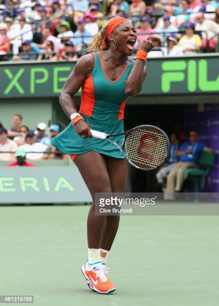 Serena Williams of the United States celebrates a point against Li Na of China during their final match during day 13 at the Sony Open at Crandon...