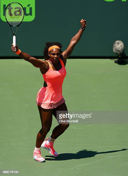 Serena Williams of the United States celebrates a point against Sabine Lisicki of Germany in their quarter final match during the Miami Open...