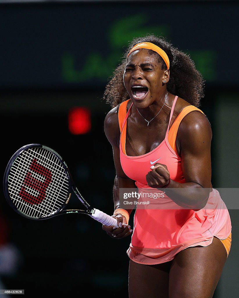 Serena Williams of the United States celebrates a point against Simona Halep of Romania in their semi final match during the Miami Open Presented by Itau at Crandon Park Tennis Center on April 2, 2015 in Key Biscayne, Florida.