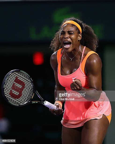 Serena Williams of the United States celebrates a point against Simona Halep of Romania in their semi final match during the Miami Open Presented by...