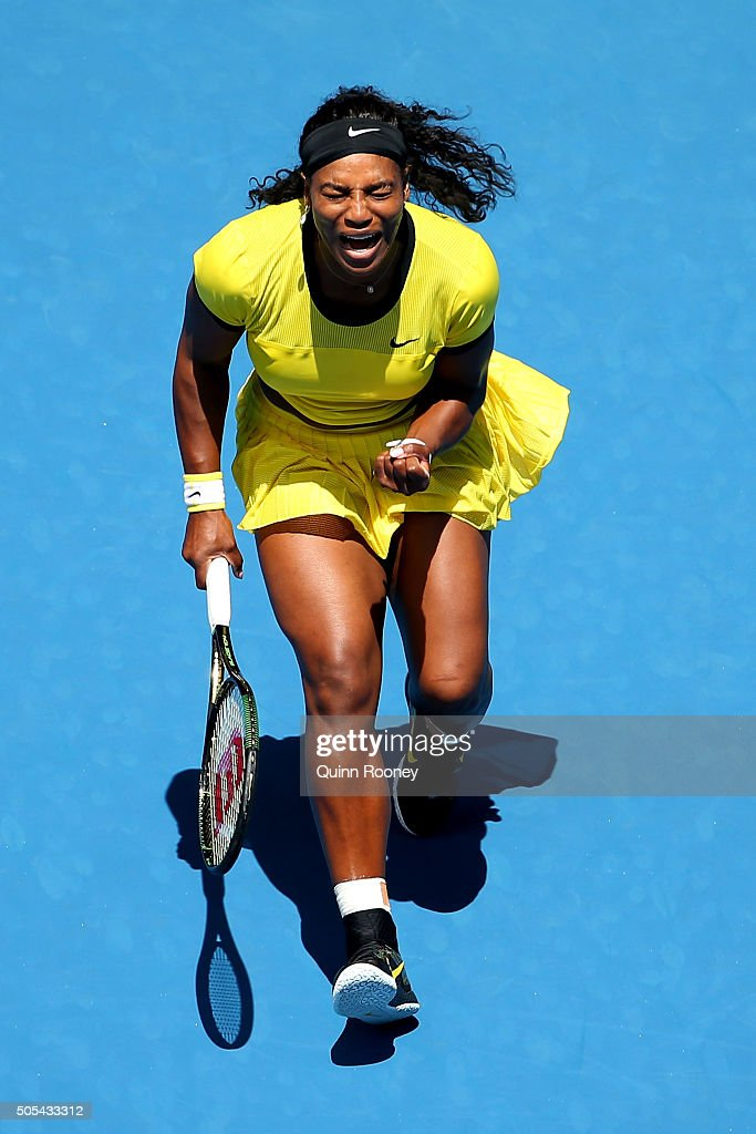 Serena Williams of the United States celebrates a point in her first round match against Camila Giorgi of Italy during day one of the 2016 Australian Open at Melbourne Park on January 18, 2016 in Melbourne, Australia.