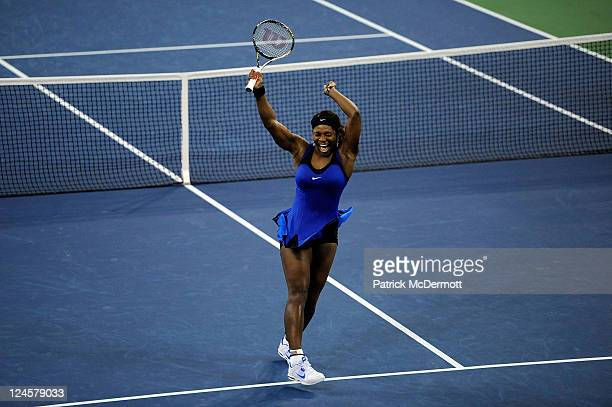 Serena Williams of the United States celebrates after she won match point against Caroline Wozniacki of Denmark during Day Thirteen of the 2011 US...
