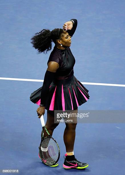 Serena Williams of the United States celebrates her victory over Ekaterina Makarova of Russia during her first round Women's Singles match on Day Two...