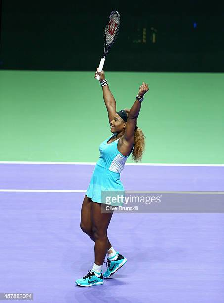 Serena Williams of the United States celebrates match point against Simona Halep of Romania the final during the BNP Paribas WTA Finals at Singapore...