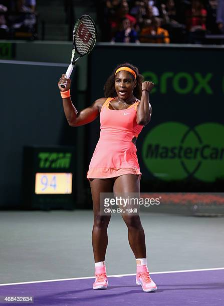 Serena Williams of the United States celebrates match point against Simona Halep of Romania in their semi final match during the Miami Open Presented...