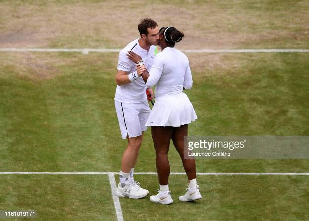 Serena Williams of the United States celebrates match point with Andy Murray of Great Britain in their Mixed Doubles second round match against...