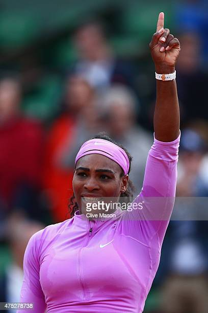 Serena Williams of the United States celebrates victory in her Women's Singles match against Victoria Azarenka of Belarus on day seven of the 2015...