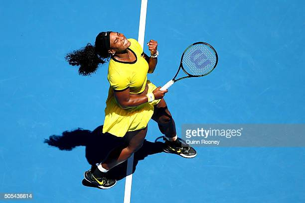 Serena Williams of the United States celebrates winning a point in her first round match against Camila Giorgi of Italy during day one of the 2016...