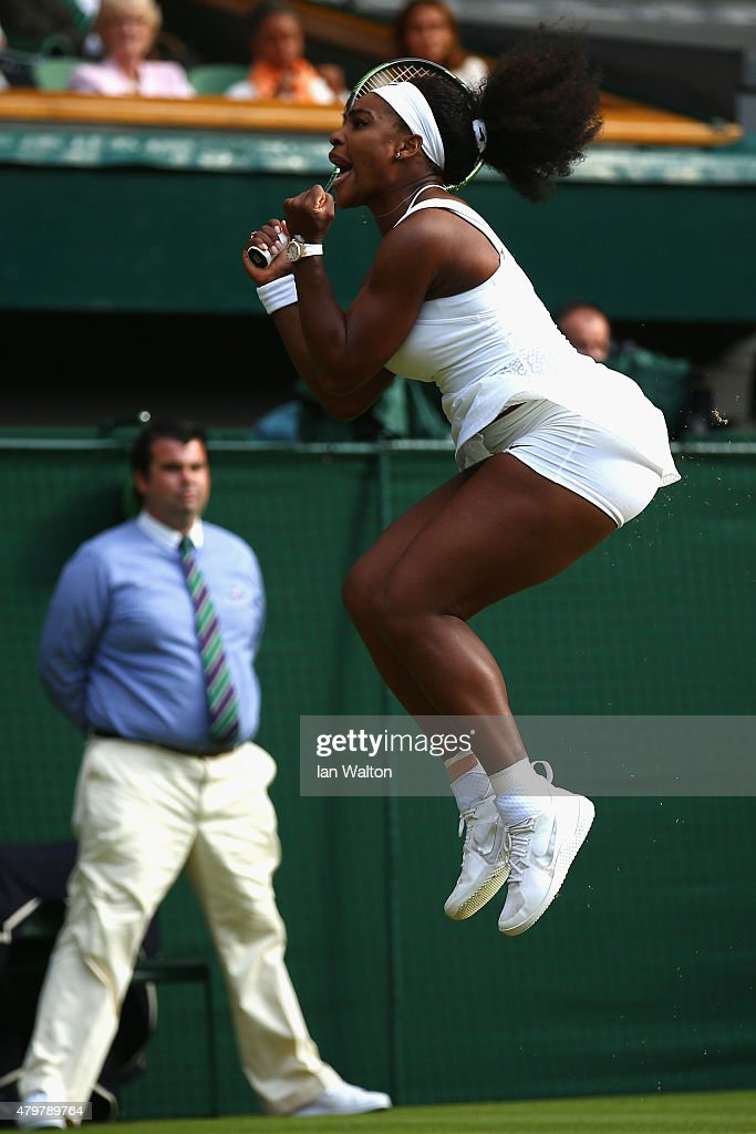 Serena Williams of the United States celebrates winning at match point in her Ladies Singles Quarter Final match against Victoria Azarenka of Belarus during day eight of the Wimbledon Lawn Tennis Championships at the All England Lawn Tennis and Croquet Club on July 7, 2015 in London, England.