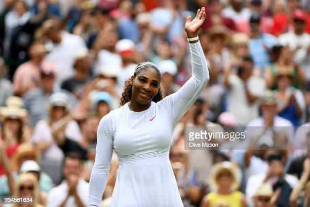 Serena Williams of the United States celebrates winning her Ladies' Singles fourth round match against Evgeniya Rodina of Russia on day seven of the...
