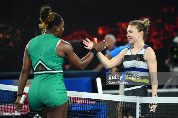 Serena Williams of the United States celebrates winning match point in her fourth round match against Simona Halep of Romania during day eight of the...