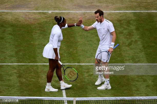 Serena Williams of the United States celebrates with Andy Murray of Great Britain in their Mixed Doubles second round match against Fabrice Martin of...