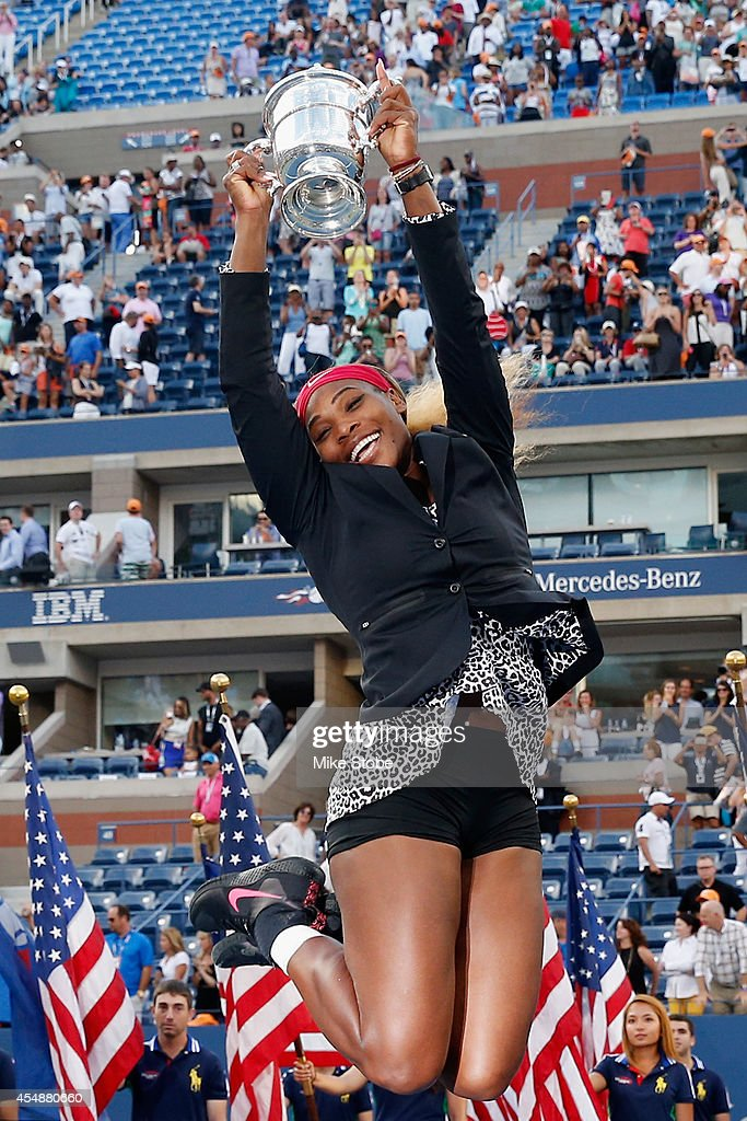 Serena Williams of the United States celebrates with the trophy after defeating Caroline Wozniacki of Denmark to win their women's singles final match on Day Fourteen of the 2014 US Open at the USTA Billie Jean King National Tennis Center on September 7, 2014 in the Flushing neighborhood of the Queens borough of New York City.