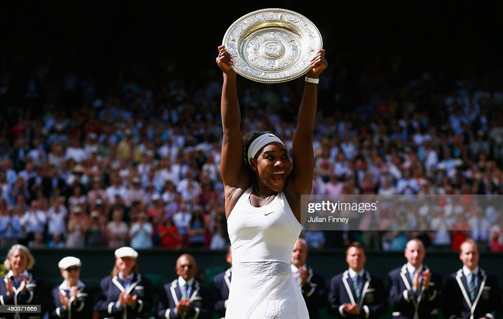Serena Williams of the United States celebrates with the Venus Rosewater Dish after her victory in the Final Of The Ladies' Singles against Garbine Muguruza of Spain during day twelve of the Wimbledon Lawn Tennis Championships at the All England Lawn Tennis and Croquet Club on July 11, 2015 in London, England.