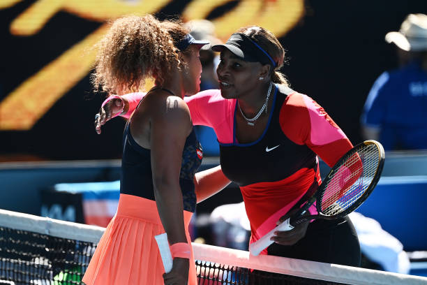Serena Williams of the United States embraces Naomi Osaka of Japan following her defeat in their Women's Singles Semifinals match during day 11 of...