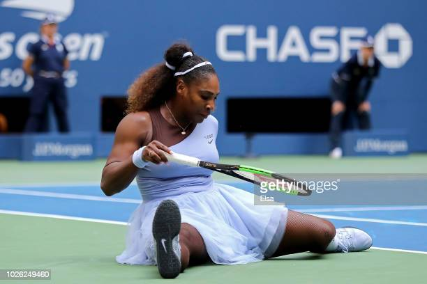 Serena Williams of The United States falls during her women's singles fourth round match against Kaia Kanepi of Estonia on Day Seven of the 2018 US...