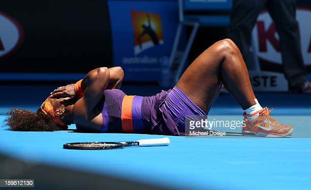 Serena Williams of the United States falls onto the court injuring her ankle in her first round match against Edina GallovitsHall of Romania during...
