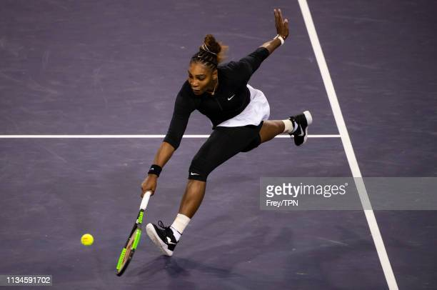 Serena Williams of the United States hits a backhand against Victoria Azarenka of Belarus in the first round of the women's singles on March 08 2019...