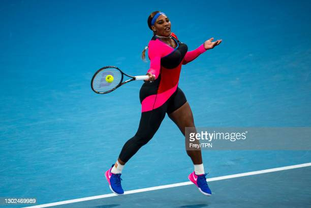 Serena Williams of the United States hits a forehand against Simon Halep of Romania during day nine of the 2021 Australian Open at Melbourne Park on...