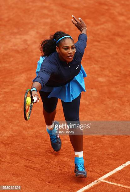 Serena Williams of the United States hits a forehand during the Ladies Singles final match against Garbine Muguruza of Spain on day fourteen of the...