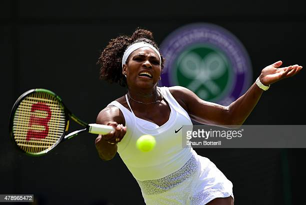 Serena Williams of the United States hits a forehand in her Ladies's Singles first round match against Margarita Gasparyan of Russia during day one...