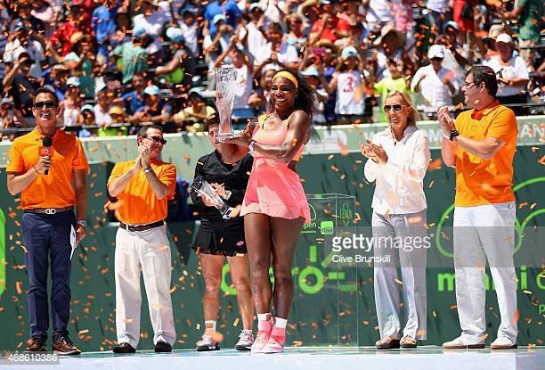Serena Williams of the United States holds aloft the Butch Bucholz Trophy after her straight sets victory against Carla Suarez Navarro of Spain in...