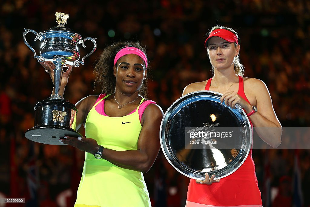 Serena Williams of the United States holds the Daphne Akhurst Memorial Cup and Maria Sharapova of Russia holds the runner up plate afte their women's final match during day 13 of the 2015 Australian Open at Melbourne Park on January 31, 2015 in Melbourne, Australia.