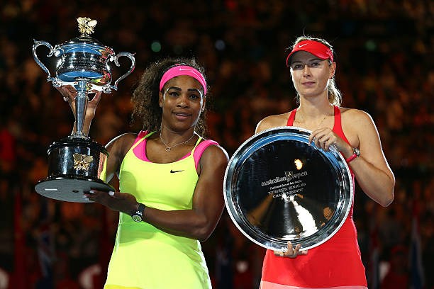 Serena Williams of the United States holds the Daphne Akhurst Memorial Cup and Maria Sharapova of Russia holds the runner up plate afte their women's...