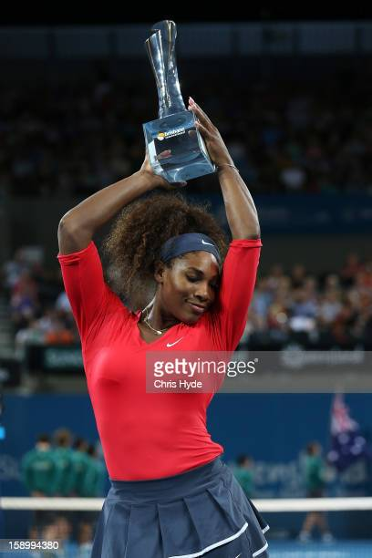 Serena Williams of the United States holds the winners trophy after winning her final match against Anastasia Pavlyuchenkova of Russia on day seven...