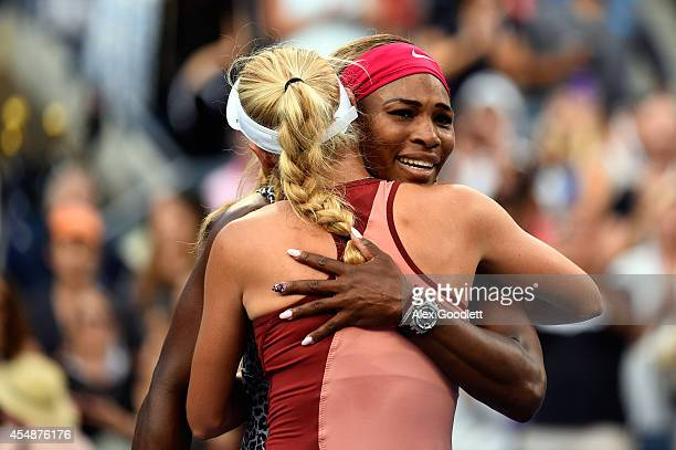 Serena Williams of the United States hugs Caroline Wozniacki of Denmark after their women's singles final match on Day fourteen of the 2014 US Open...