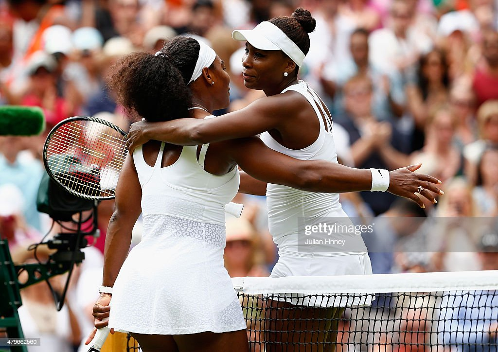 Serena Williams of the United States hugs Venus Williams of the United States after their Ladies' Singles Fourth Round match during day seven of the Wimbledon Lawn Tennis Championships at the All England Lawn Tennis and Croquet Club on July 6, 2015 in London, England.