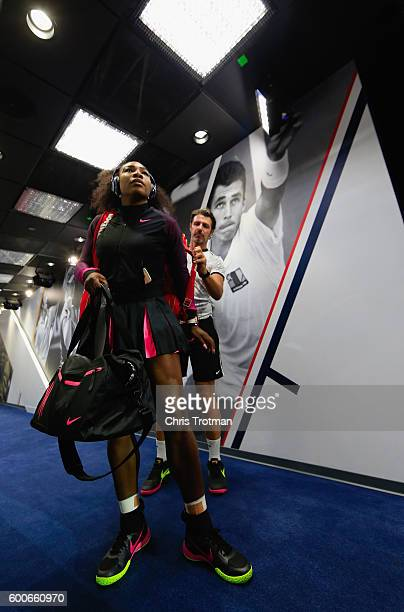 Serena Williams of the United States is assisted by coach Patrick Mouratoglou on her way to the court before playing against Karolina Pliskova of the...