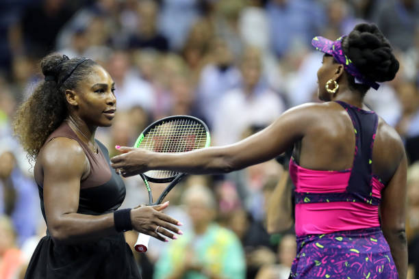 Serena Williams of The United States is congratulated by her sister and opponant Venus Williams of The United States following their ladies singles...
