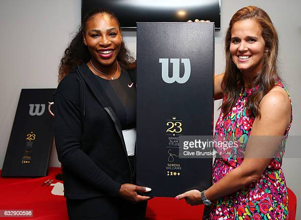 Serena Williams of the United States is presented with a special 23 Grand Slam Tennis Racket by Mary Joe Fernandez after winning the 2017 Women's...