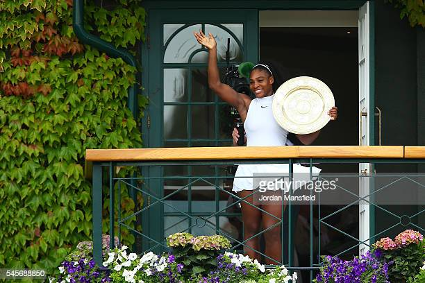 Serena Williams of The United States lifts the trophy infront of the fans from The Members balcony following victory in The Ladies Singles Final...