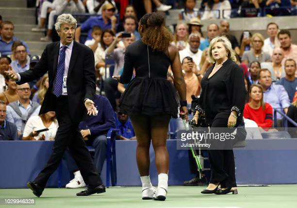 Serena Williams of the United States looks on as grand slam supervisor Donna Kelso and referee Brian Earley enter the court during her Women's...