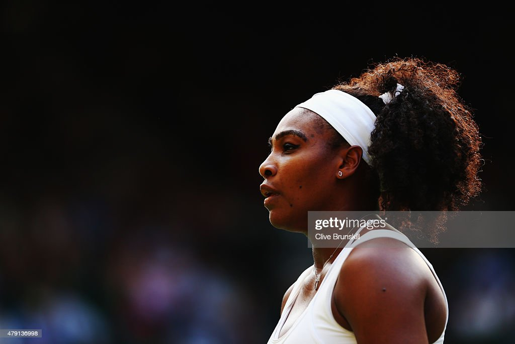 Serena Williams of the United States looks on in her Ladies Singles Second Round match against Timea Babos of Hungary during day three of the Wimbledon Lawn Tennis Championships at the All England Lawn Tennis and Croquet Club on July 1, 2015 in London, England.