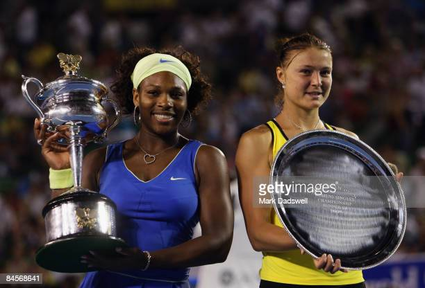 Serena Williams of the United States of America and Dinara Safina of Russia pose with their trophies after the women's final match against Dinara...
