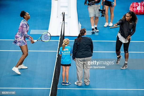Serena Williams of the United States of America and Venus Williams of the United States of America prepare for the coin toss during the Womens...