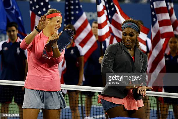 Serena Williams of the United States of America and Victoria Azarenka of Belarus joke around during the trophy presentation after their women's...