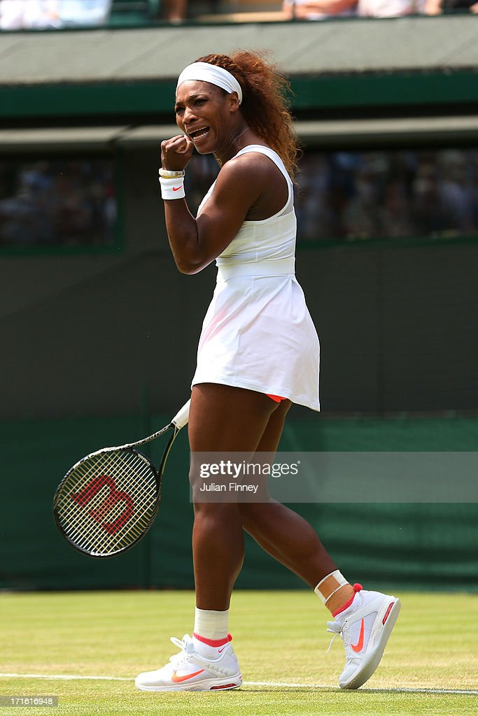 Serena Williams of the United States of America celebrates a point during the Ladies' Singles second round match against Caroline Garcia of France on day four of the Wimbledon Lawn Tennis Championships at the All England Lawn Tennis and Croquet Club on June 27, 2013 in London, England.