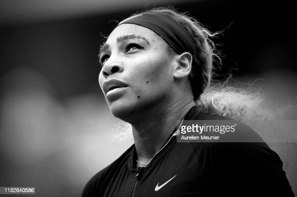 Serena Williams of The United States of America looks on during her ladies singles first round match against Kurumi Nara of Japan during Day five of...