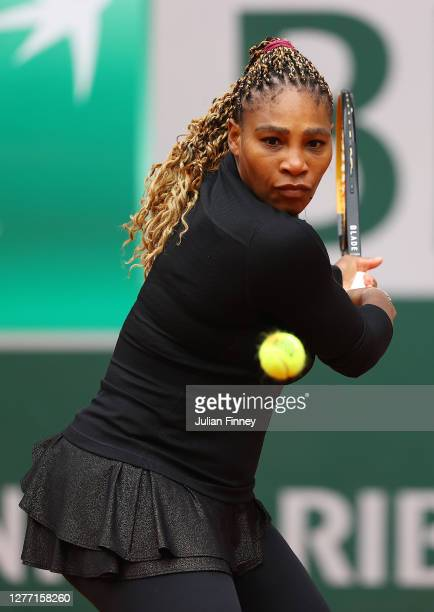 Serena Williams of The United States of America plays a backhand during her Women's Singles first round match against Kristie Ahn of The United...