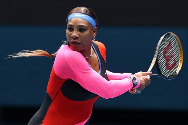 Serena Williams of The United States of America plays a backhand in her Women's Singles first round match against Laura Siegemund of Germany during...